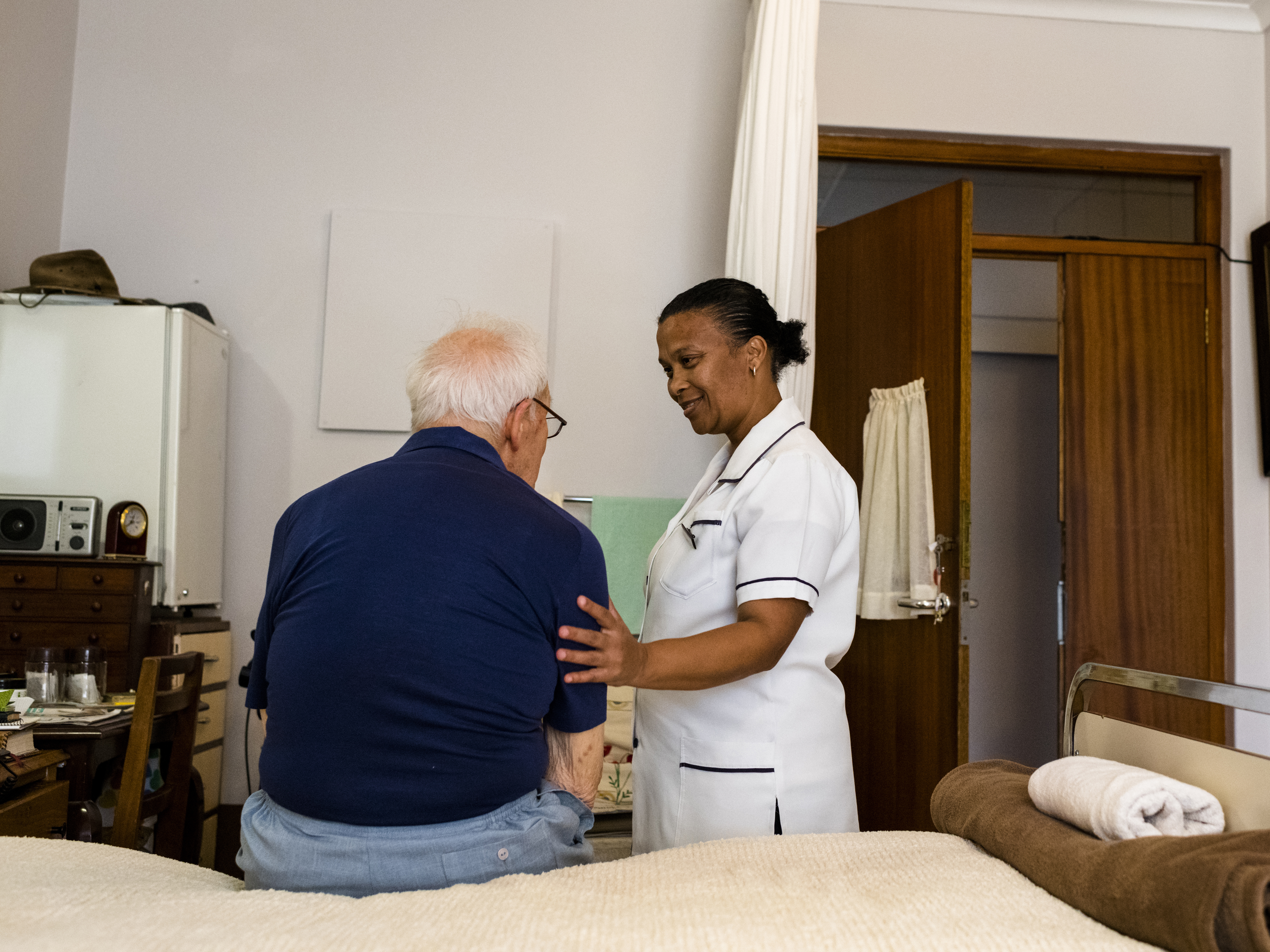 Nurse with an older resident at a nursing home.