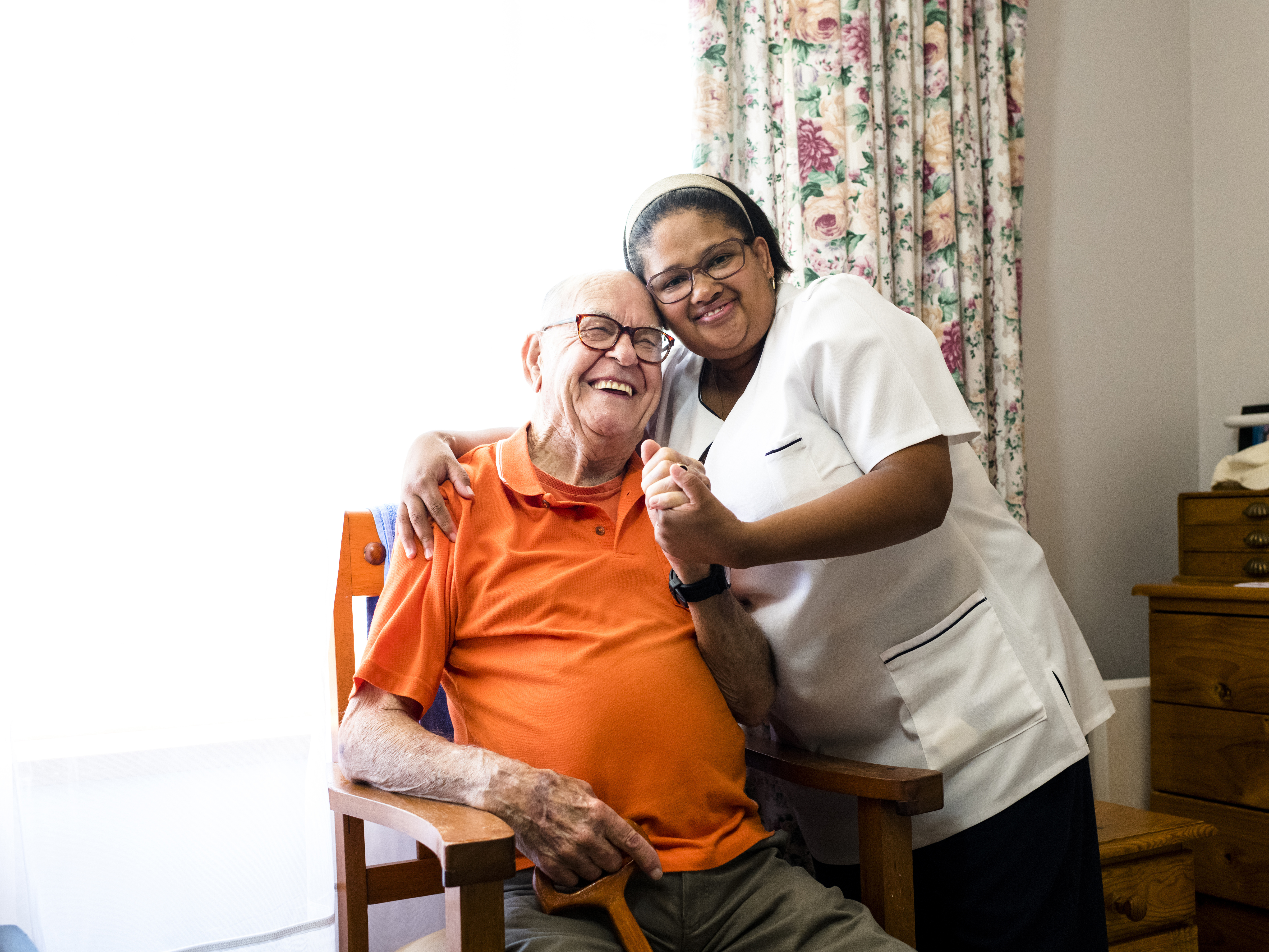 Older person at home with their carer.