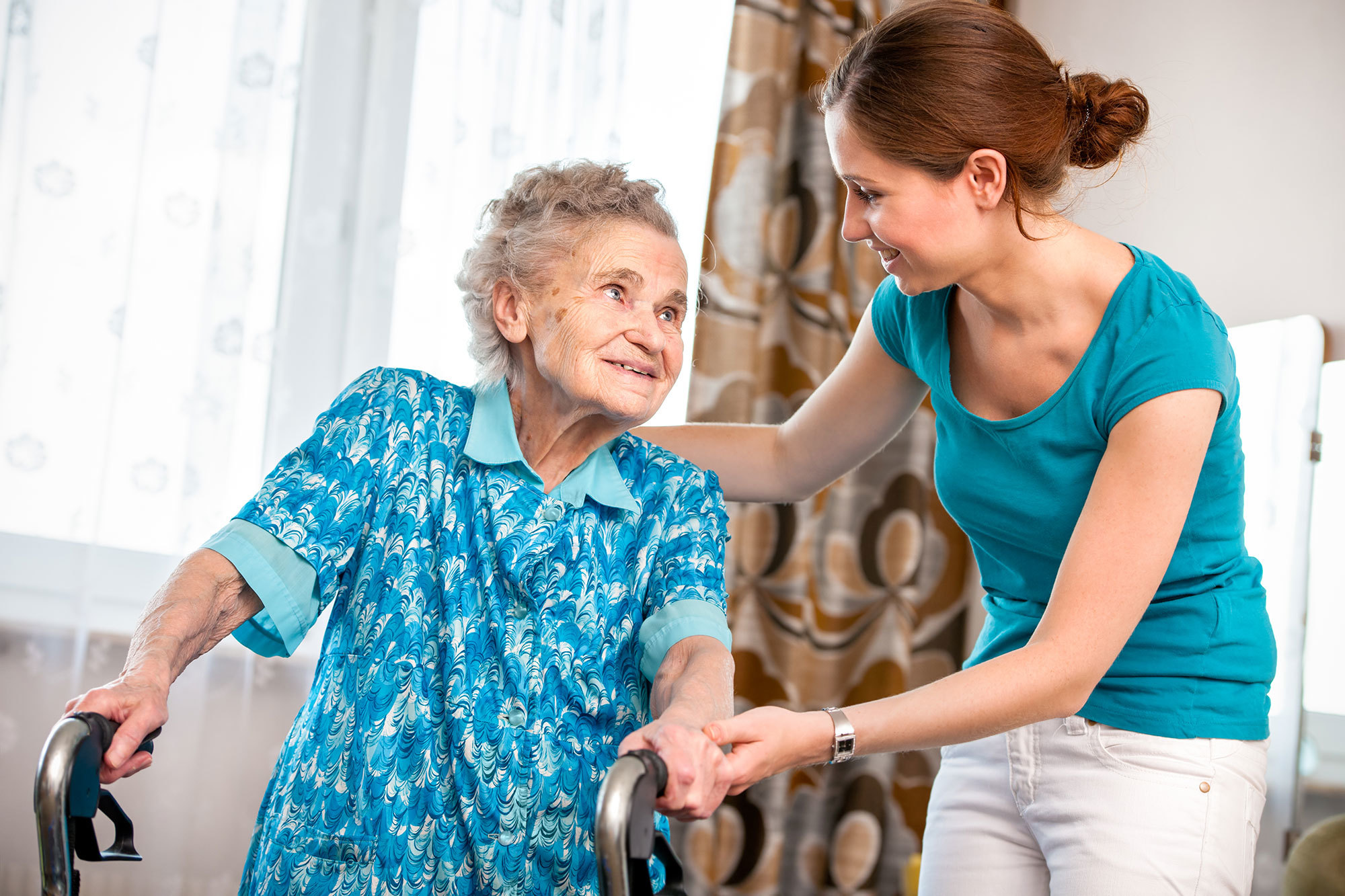 Older woman with a personal care assistant