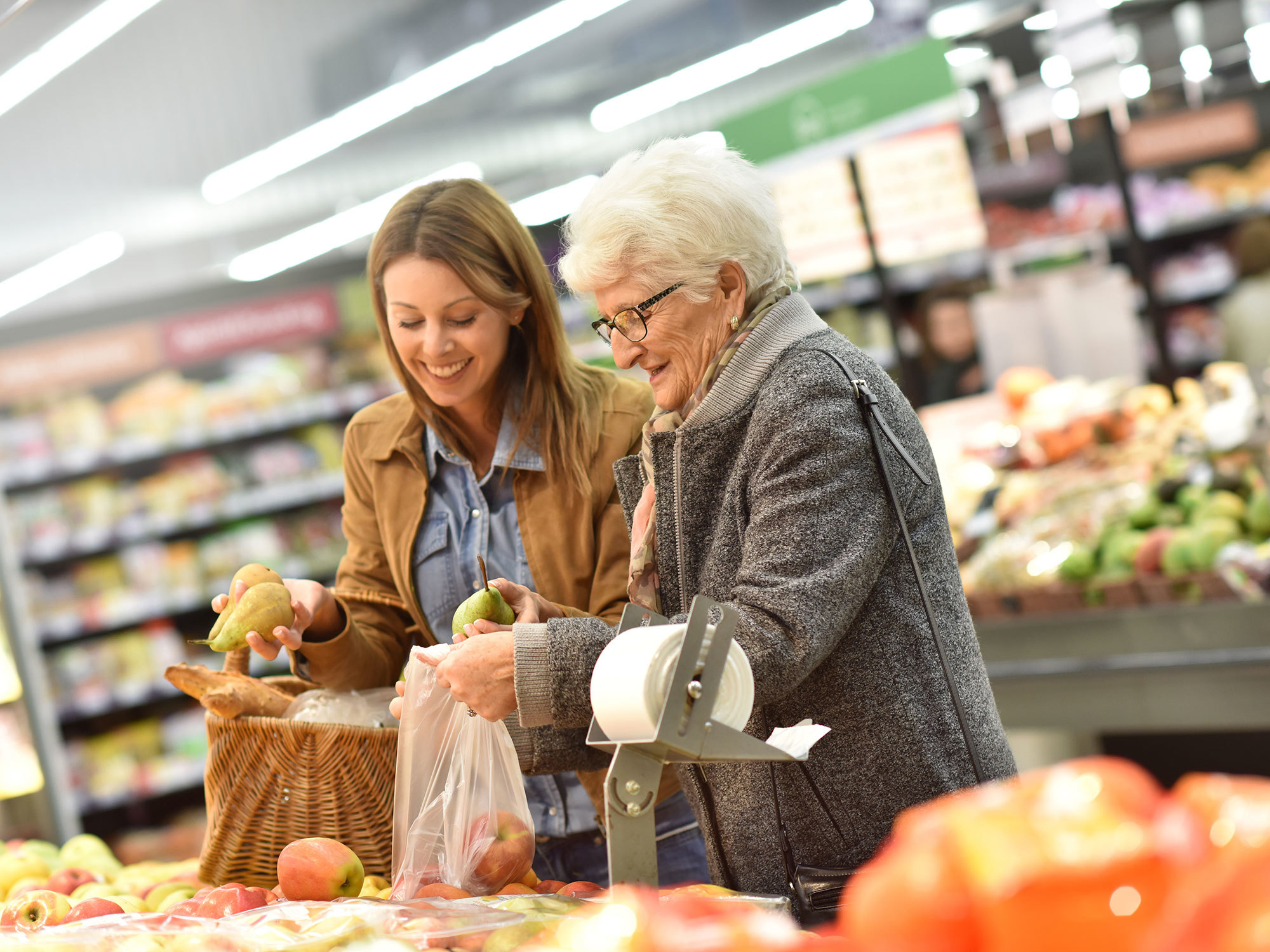 Older woman receiving carer assistance while shopping