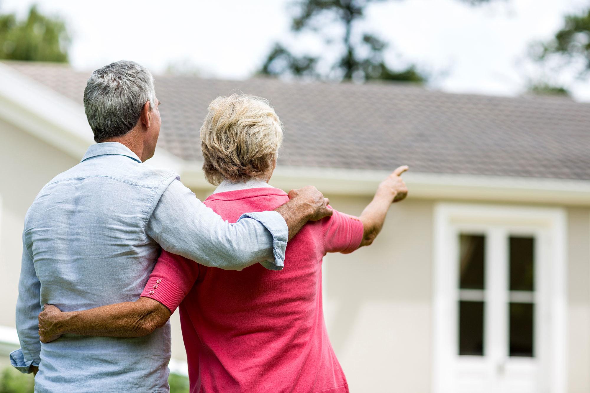 Older couple outside their retirement village