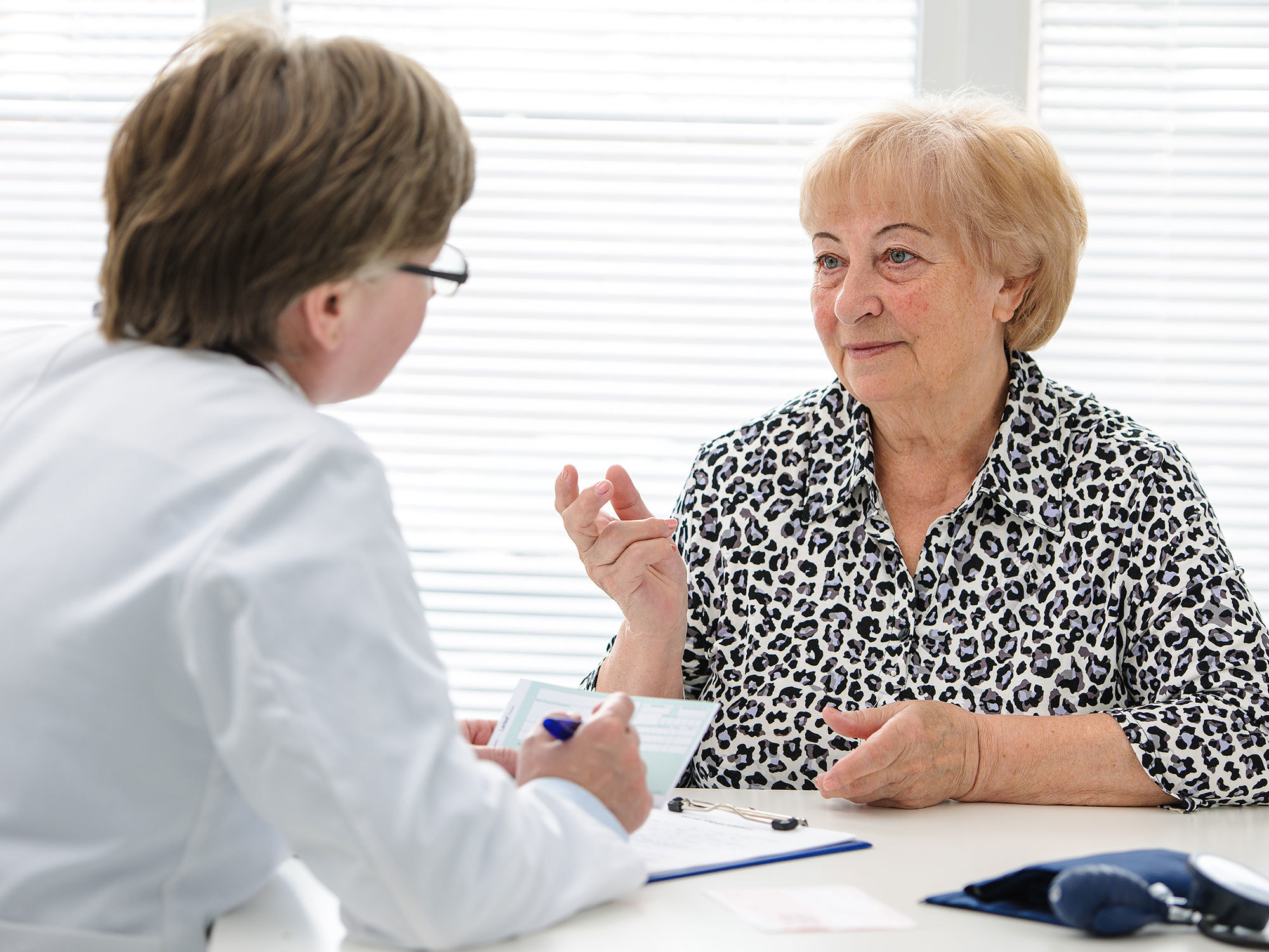 Older woman talking with her case manager