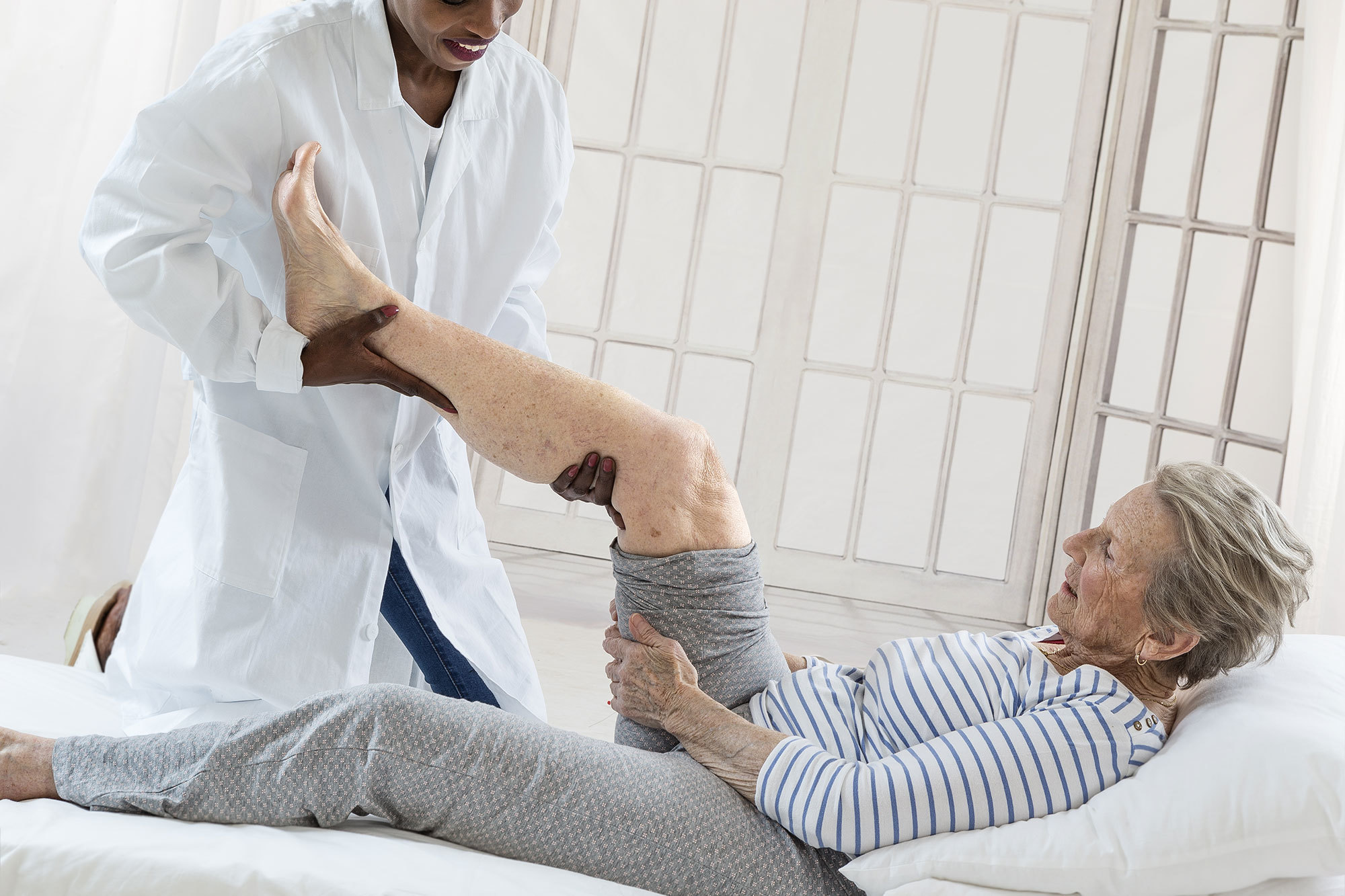 Older woman receiving physiotherapy at a Day Therapy Centre