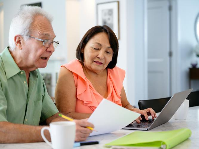 Couple together looking over finances