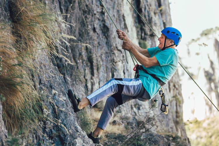 Old man rock climbing