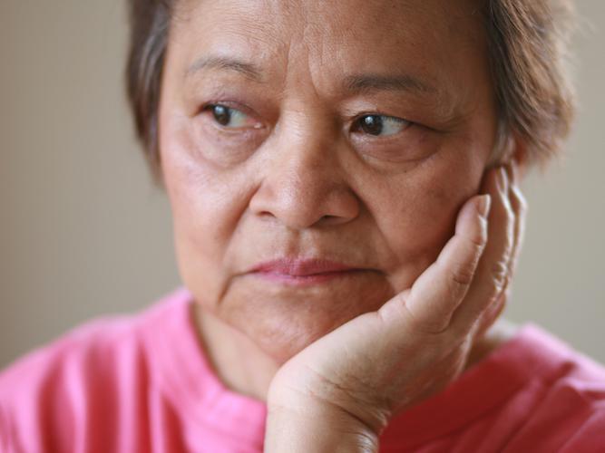 Older woman looking worried