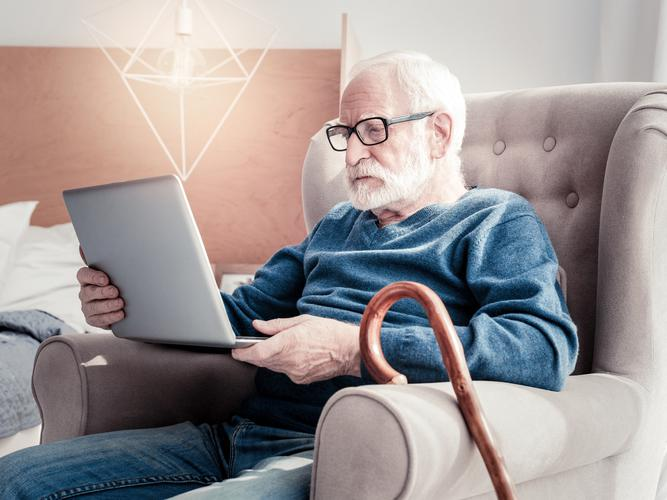 Man on his laptop searching the My Aged Care website