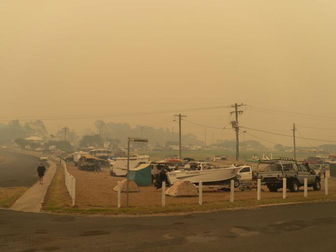 People in New South Wales evacuating from their homes during raging bushfires.