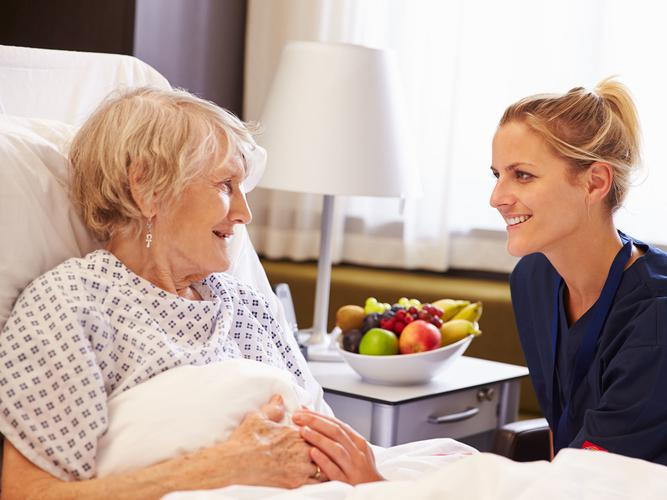 Older person with a transition care worker