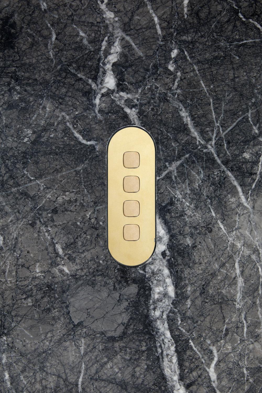 4 gang switch brass brassbuttons stone dark horizontal
