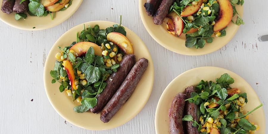 I Quit Sugar - Kangaroo Sausages with Grilled Peach, Corn + Watercress Salad