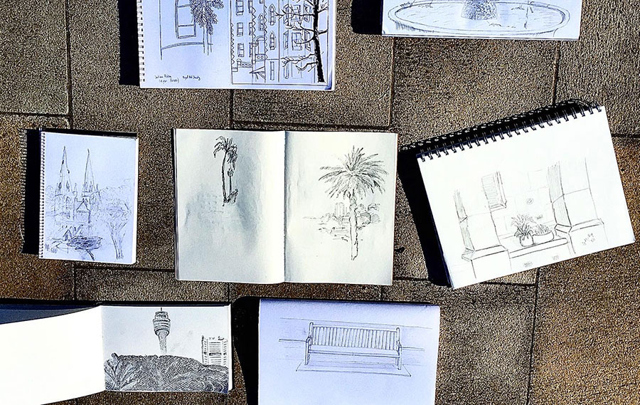 Art books with urban sketches laid on the floor
