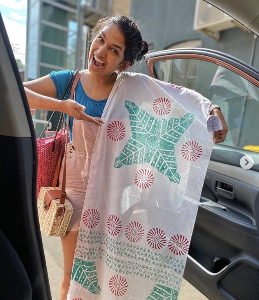 Shmruthi enthusiastically holding her fabric block print