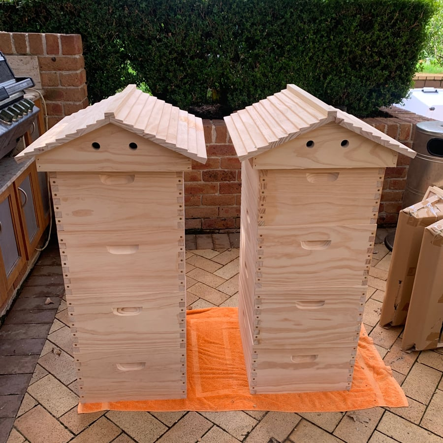 Two completed bee hives ready for bees