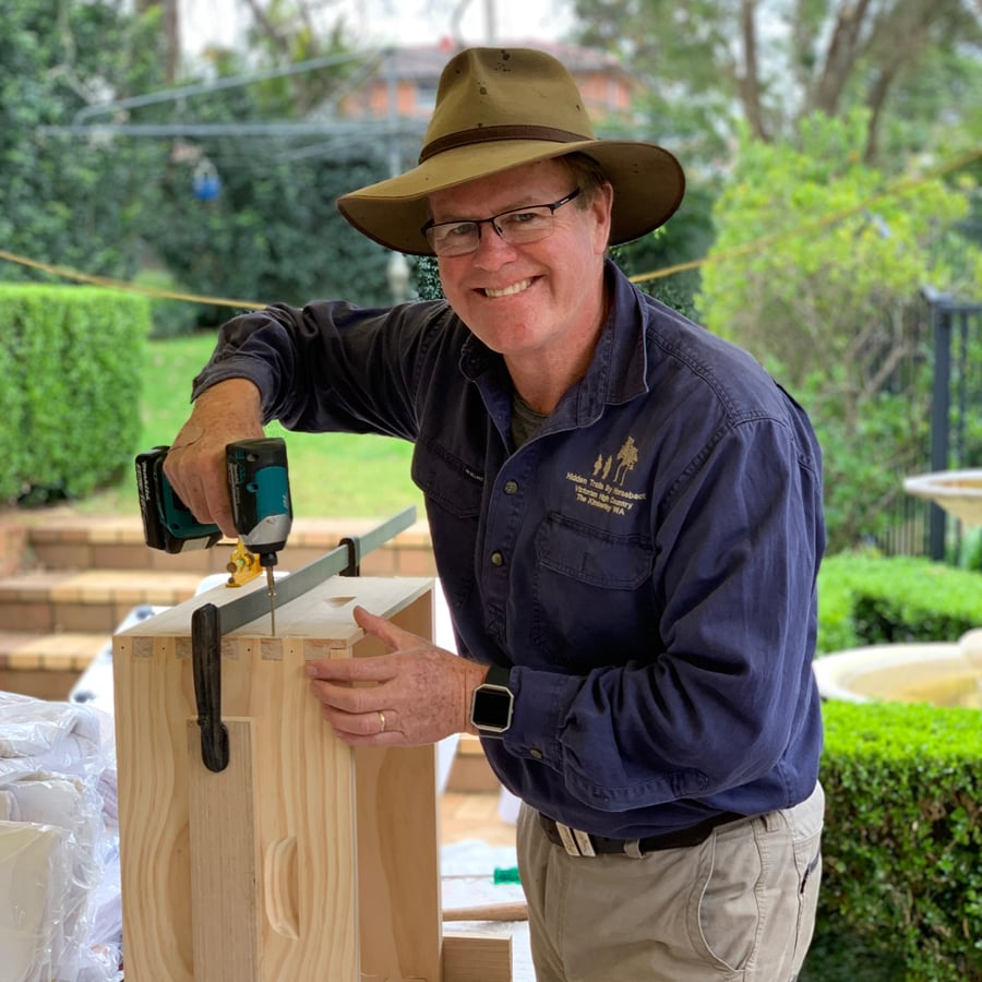 Geoff Begg constructing a wooden bee hive