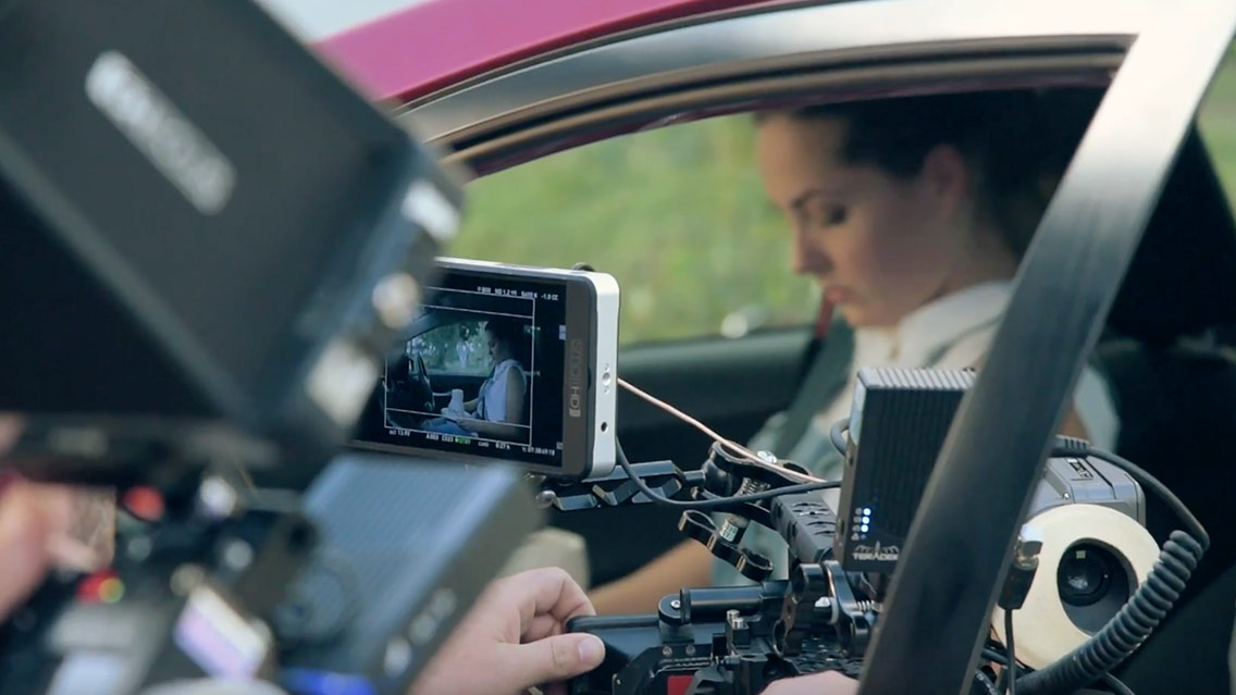 Behind the scenes shot of camera mounted to red car