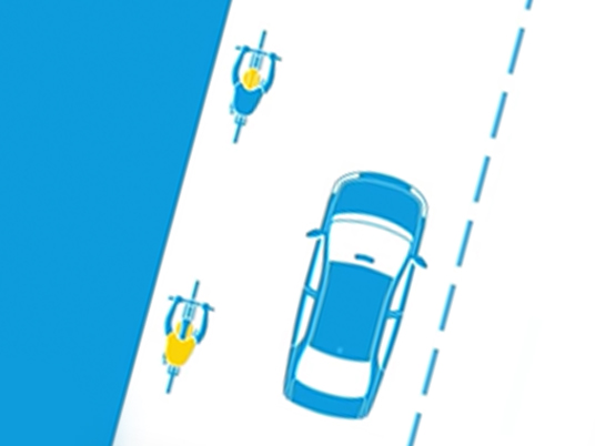Overhead illustration showing cars passing a cyclist