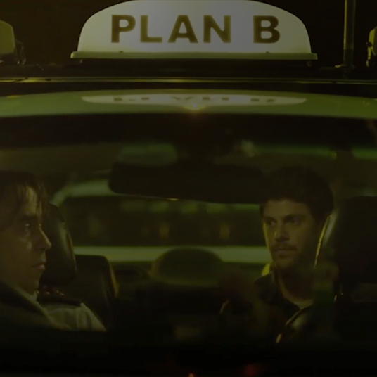 Passengers in a taxi with Plan B printed on it's light