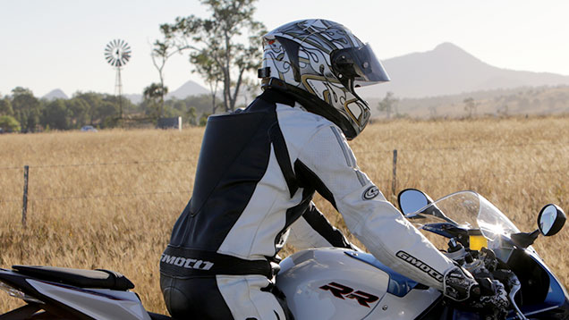 Motorcycle rider with protective clothing