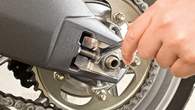 Motorcycle wheel with tool
