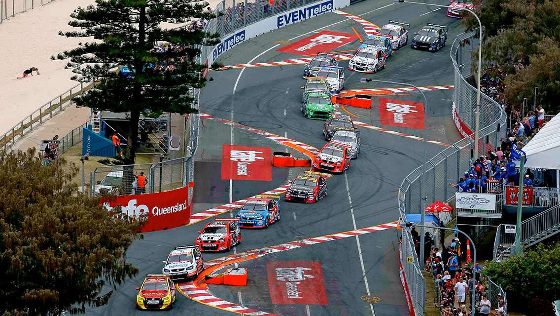Overhead view of the race cars snaking through a multiple chicane section of the track