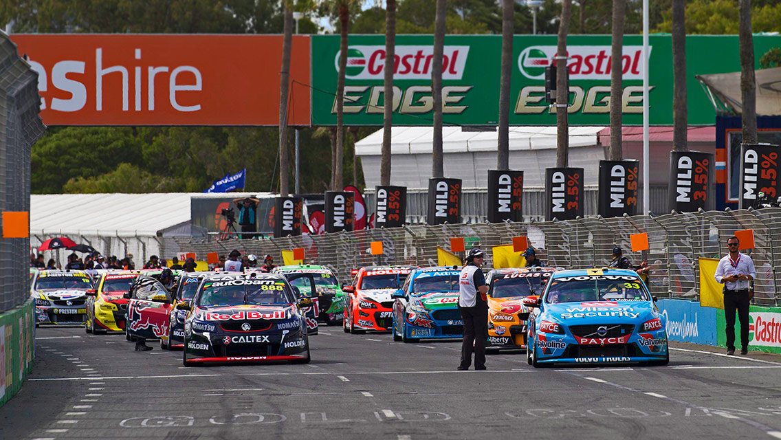 Race cars lined up on the grid ready for the start