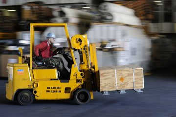 warehouse forklift carrying load