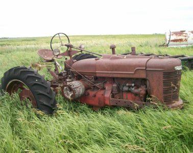 Rusty tractor in field
