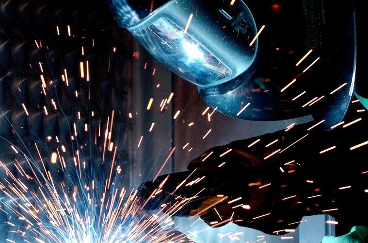 welder working with helmet