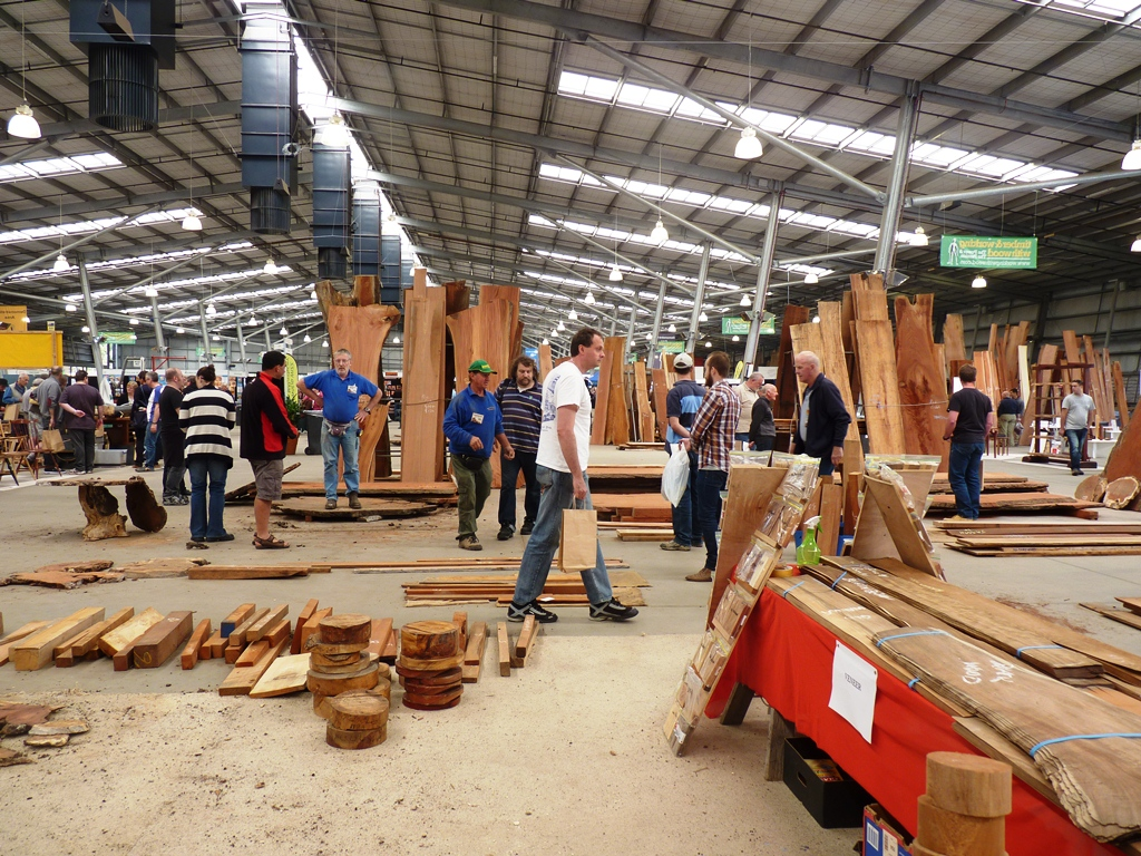 A happy visitor tours the floor of the Timber expo