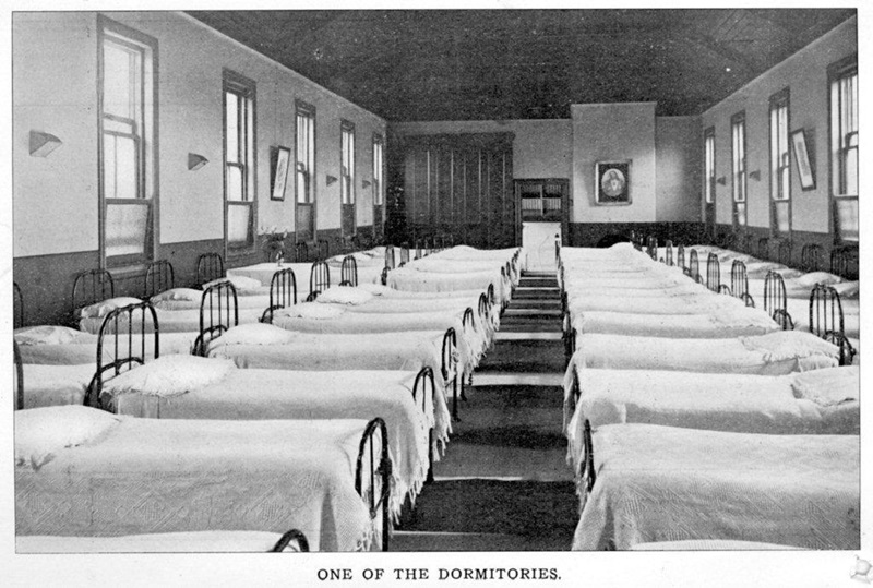 Black and white historic photo of one of the dormitories in South Melbourne building.