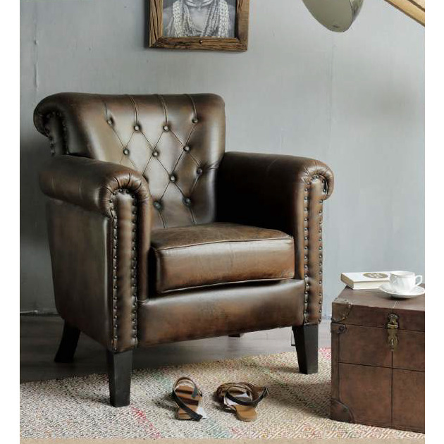 STUDDED BROWN LEATHER ARMCHAIR