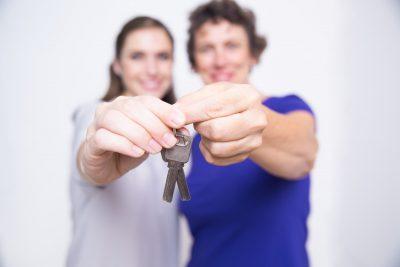 Women holding flat keys together