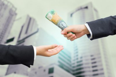 money-hand-over-australia-borrow-cash-wealth-mortgage-loan-building-1160x773