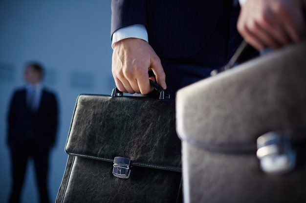 close-up-of-workers-with-briefcases_1098-3096.jpg
