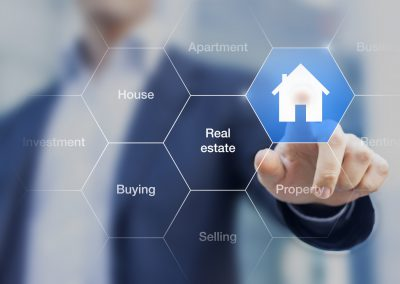 Real Estate Agent Pushing A Button With A House