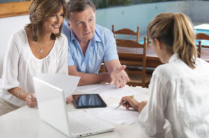Happy mature couple in a meeting with an adviser