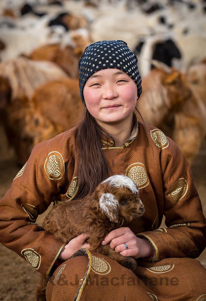 Nomadic girl with babe goat, Western Mongolia