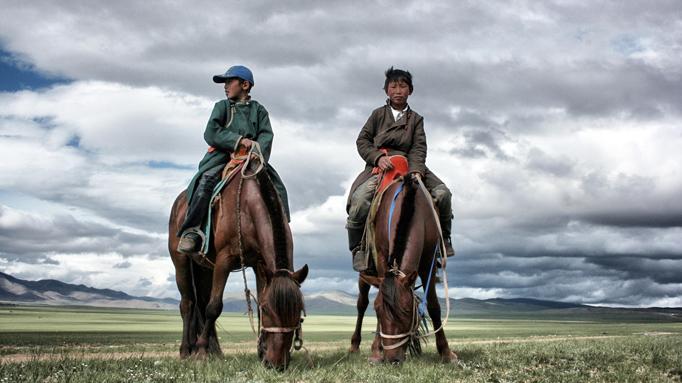 Horse herder boys, Mongolia