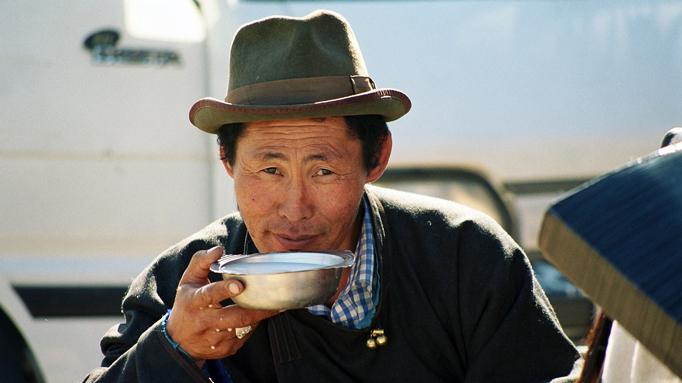 Nomadic man drinking airag, fermented mare's milk, Mongolia