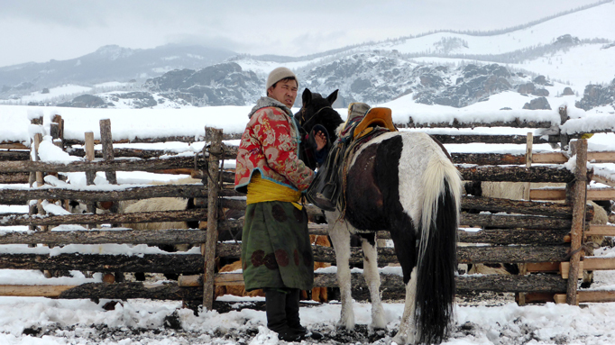 Mongolia horseman in winter