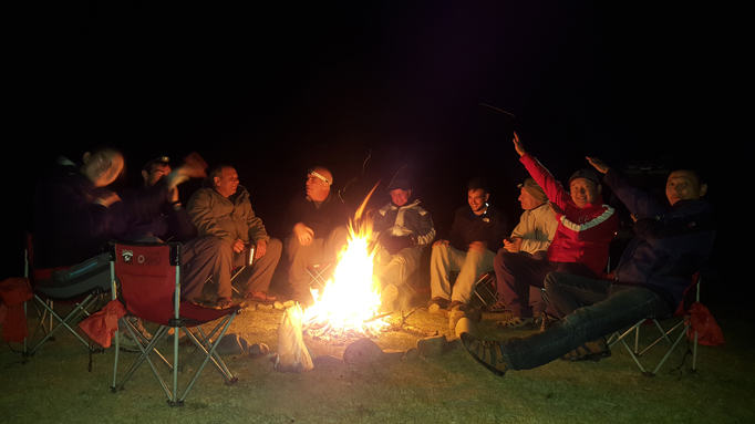 Sitting around camp fire, Mongolia