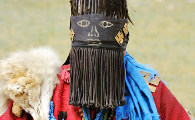 Mongolian shaman with face cover