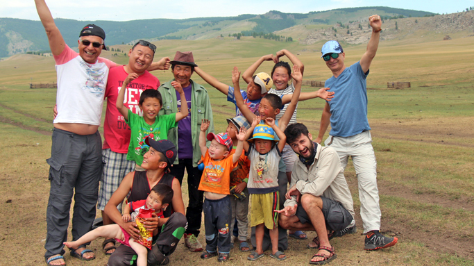 Tourists with nomadic family children