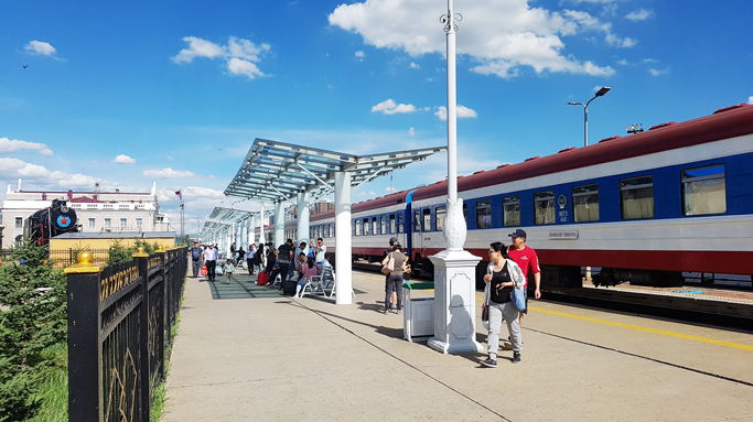 People waiting to board train at Trans-Mongolian railway station