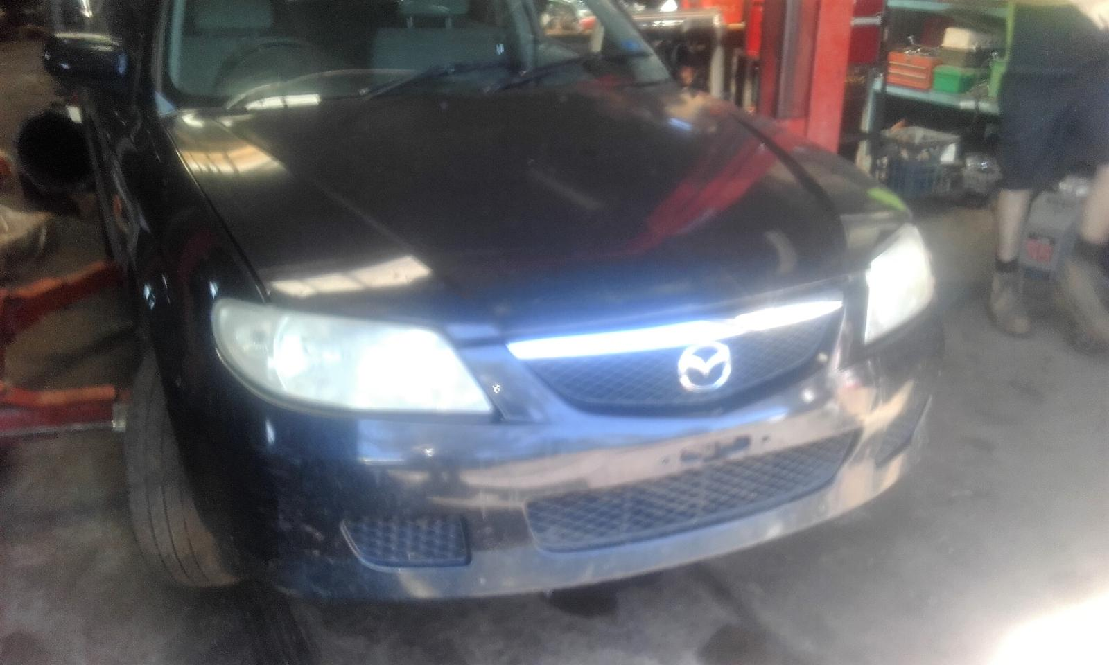 View Auto part Overflow Bottle Mazda 323 2001
