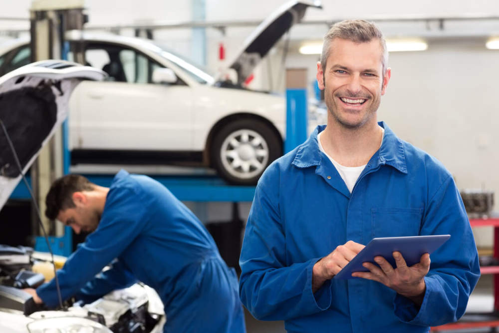 Mechanic conducting a Certificate of Roadworthiness inspection.