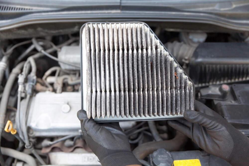 A dirty car air filter that needs replacing.