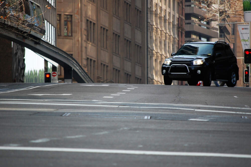 4WD driving through cityscape.