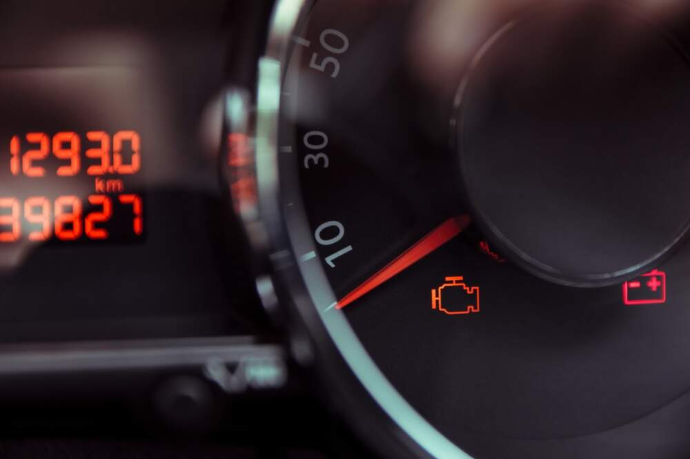Check engine light is showing on a car dashboard.